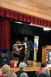 Adrian Crookston provides musical entertainment.
