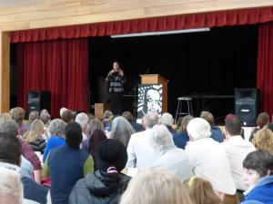 Nikkita Oliver recites a poem.